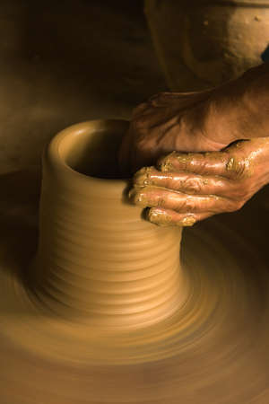 Hands of a pottery maker