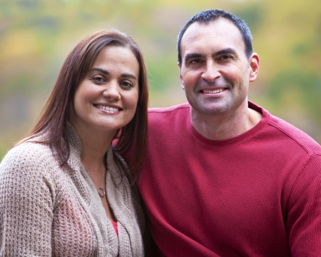Hispanic couple outdoor portrait in the Fall