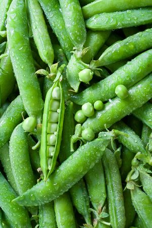 Top view of fresh washed green peas [pisum sativum]