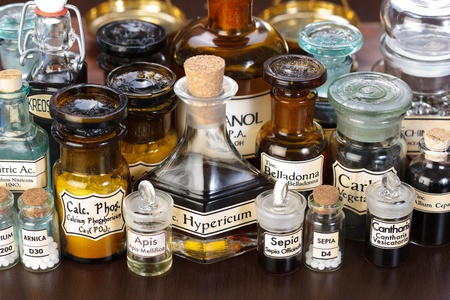Various pharmacy bottles of homeopathic medicine on dark background