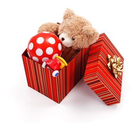 Foto de Big wrapped gift box full of various toys - Imagen libre de derechos