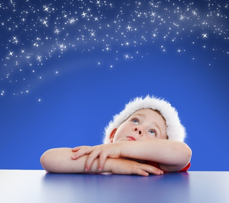 Little boy looking up to copy space, stars on night sky