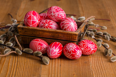 Transylvanian hand written Easter eggs surrounded by willow branches
