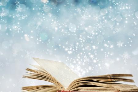 Photo pour Christmas fairy-tale. Christmas background with magic book - image libre de droit