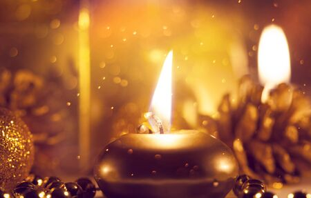 Candles and ornaments and beautiful Christmas lights - Holiday atmosphere background