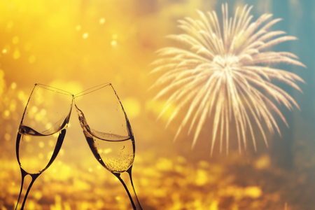 Photo pour Glasses with champagne against fireworks and holiday lights - Celebrating the New Year - image libre de droit