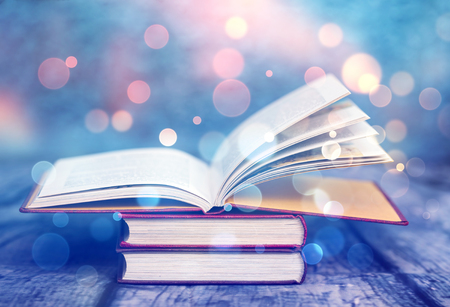 Photo for Open book with magic lights. Concept of wisdom, religion, reading, imagination, winter holidays - Royalty Free Image