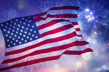 Foto de Celebrating Independence Day. United States of America USA flag with fireworks background for 4th of July - Imagen libre de derechos