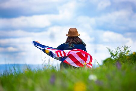 Photo for Young woman holding american USA flag. Independence Day or traveling in America concept. - Royalty Free Image