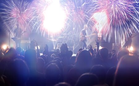 Photo pour New Year concept - fireworks and cheering crowd celebrating the New Year - image libre de droit
