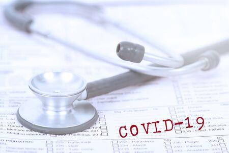 Photo pour Concept of COVID-19 - Coronavirus disease - 2019-nCoV, corona virus. Stethoscope close up photo.The inscription coronovirus COVID-19 - image libre de droit