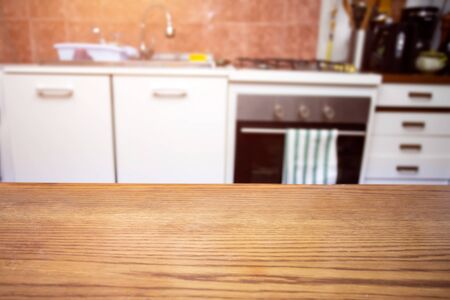 Photo pour Wood table top on blurred kitchen room background. - image libre de droit
