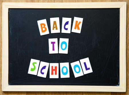 Photo pour Welcome back to school text on blackboard. - image libre de droit