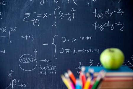 Photo pour Back to School Concept. Accessories and books against chalkboard. - image libre de droit