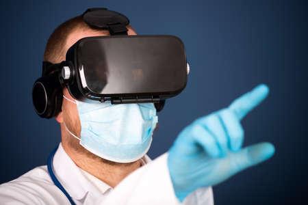 Foto de VR medicine. Doctor using virtual reality headset for medical purposes. - Imagen libre de derechos