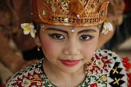 JAKARTA, INDONESIA - JULY 23, 2006: Young Balinese dancer is posing after performing her traditional Balinese dance on July 23, 2006 in Jakarta.