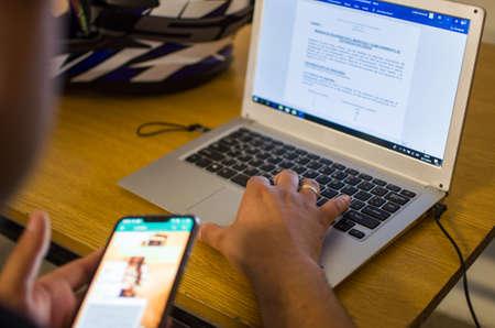 Foto de Hands on a notebook or laptop. working. studying - Imagen libre de derechos