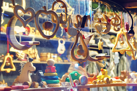 Close-up image of a stand with wooden toys and Christmas tree decorations at the Christmas Market in Old Riga, Latvia