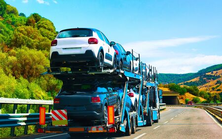Photo for Car transporter on road in Nuoro Sardinia reflex - Royalty Free Image