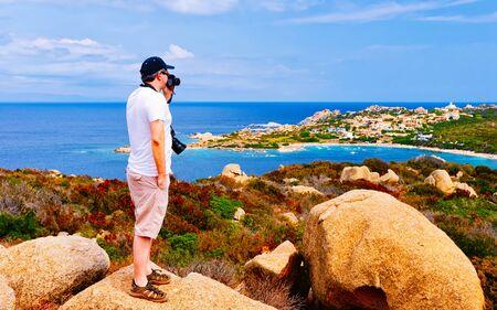 Photo for Man and Landscape with Rocky coast of Capo Testa in Santa Teresa Gallura at the Mediterranean Sea on Sardinia Island in Summer Italy. Scenery of Cagliari province. Mixed media. - Royalty Free Image