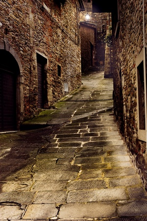 tuscan dark alley at night, dirty corner of street in the old village