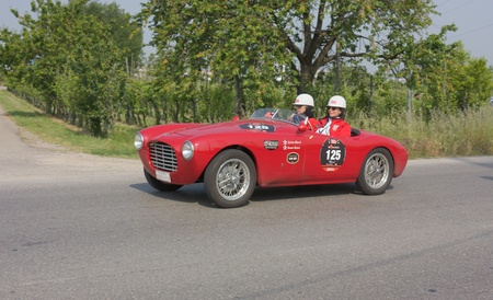 FORLI', ITALY - MAY 13: S.M.A. Oberti and S.C. Royce drives a Siata 750 Spider BC (1951) in stage Bologna-Roma of the Mille miglia historical race for classic cars, on May 13 2011 in Forli', Italy