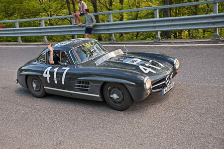 Photo for vintage racing car Mercedes-Benz 300 SL Coupe W198 (1956) in historic classic race Mille Miglia on May 21, 2016 in Passo della Futa (FI) Italy - Royalty Free Image