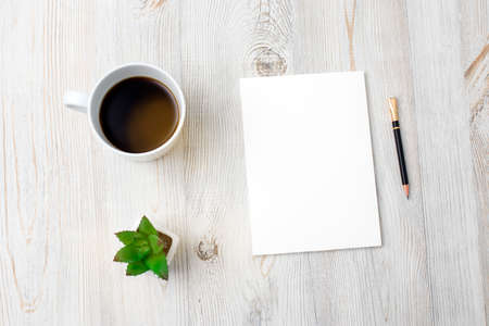 Photo for Home office workplace with cup of coffee, note pad and pen. Working from home concept. Artificial succulents in ceramic pots on a beige wooden table surface. Top view - Image. Copy space - Royalty Free Image