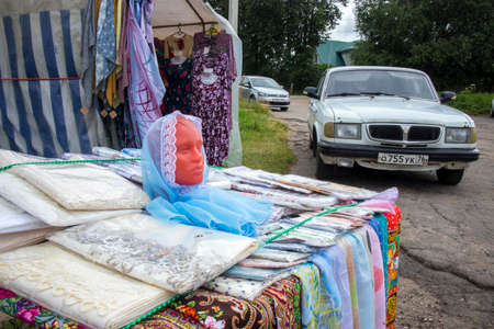 Pereslavl-Zalessky, Russia, - 20 July 2020, Selling things on the street in a tent near Goritsky assumption monastery.