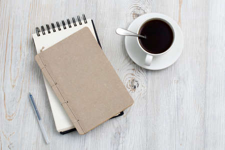Photo for desk office with blank notepad, coffee cup and pen on wood table. Flat lay top view copy space. Top view - Royalty Free Image