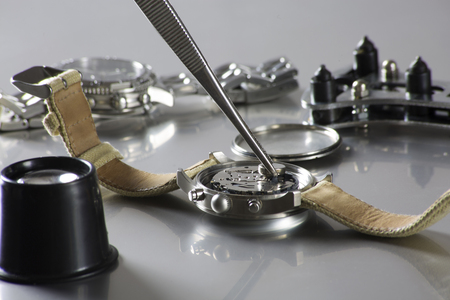 macro of replacing a watch battery with watchmaker tools