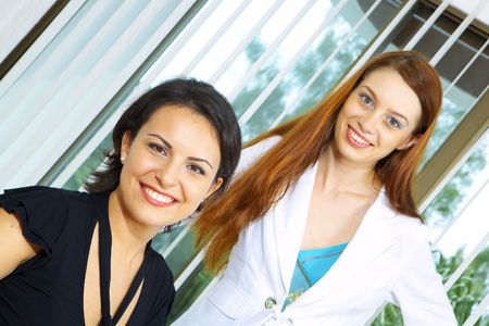 portrait of two girls in office environment