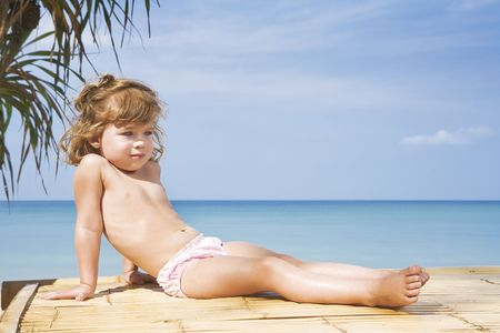 Photo for Portrait of nice little girl having fun on the beach - Royalty Free Image
