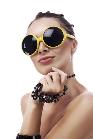 Portrait of  young gorgeous woman in funky yellow sunglasses
