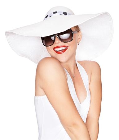 Foto de portrait of young beautiful woman in hat and sunglasses - Imagen libre de derechos