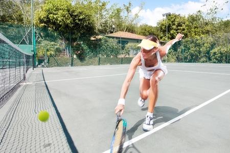 Foto de portrait of young beautiful woman playing tennis in summer environment - Imagen libre de derechos