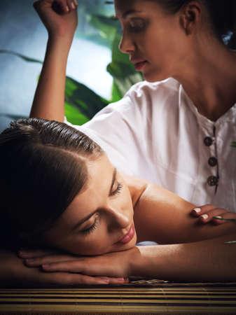 Foto de portrait of young beautiful woman in spa environment - Imagen libre de derechos