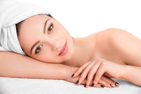 Photo pour Young beautiful  attractive woman receiving facial massage and spa treatment over white background. Perfect Skin. Skincare. Young Skin - image libre de droit