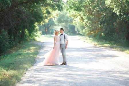 Foto de wedding couple on the nature in summer day. - Imagen libre de derechos