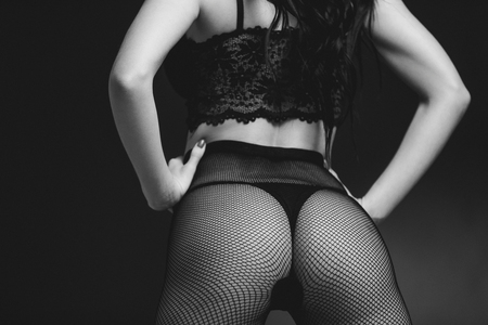 Photo for Sexy butt woman in lace black sensual lingerie and pantyhose on black background. Luxury ass in stockings - Royalty Free Image
