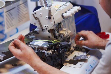 Foto für Sewing machine and overlock repairing process, masters hands, tools, details - Lizenzfreies Bild