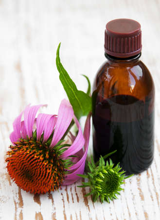 Photo pour Flowers and Echinacea tincture  on a wooden background - image libre de droit