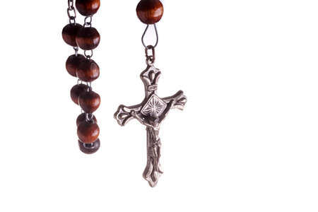 Wooden Rosary Beads and Cross, hanging. Isolated on White