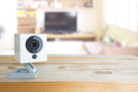 Photo pour Security camera on Wood table. IP Camera. - image libre de droit