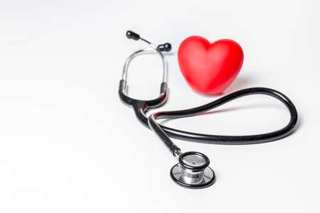 Photo pour Stethoscope and red heart. Heart Check. Concept healthcare. - image libre de droit