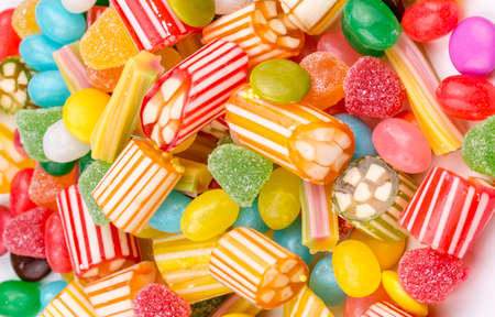 Photo for Colorful lollipops and different colored round candy. Top view. - Royalty Free Image