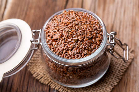 Photo for Flax seeds on a wooden background - Royalty Free Image