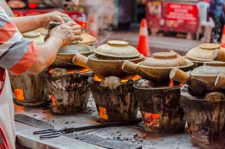 Street Food preparation with clay pots in Kuala Lumpur, Malaysia