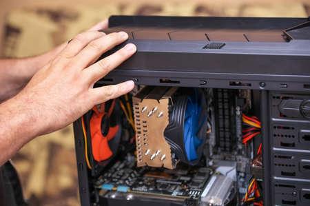 Computer Technician Assembles A Computer. Build A Home Pc