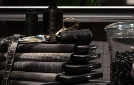 Foto de Still Life of Tailor's Shop with Tools of the Trade and Cloth - Imagen libre de derechos
